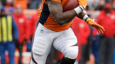 Denver Broncos running back C.J. Anderson (22) carries against the Kansas City Chiefs during the first half of an NFL football game Sunday, Dec. 31, 2017, in Denver. (AP Photo/Jack Dempsey)