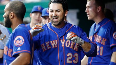 New York Mets' Adrian Gonzalez celebrates in the dugout after hitting a solo home run off Cincinnati Reds relief pitcher Jackson Stephens in the fifth inning of a baseball game, Monday, May 7, 2018, in Cincinnati. (AP Photo/John Minchillo)