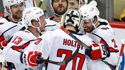 Washington Capitals goaltender Braden Holtby (70) celebrates with Evgeny Kuznetsov (92), Jakub Vrana (13), Alex Ovechkin, top center, and Matt Niskanen (2) after Kuznetsovs' game-winning goal during the overtime period in Game 6 of an NHL second-round hockey playoff series against the Pittsburgh Penguins in Pittsburgh, Monday, May 7, 2018. The Capitals won the game 2-1 to take the series, four games to two. (AP Photo/Gene J. Puskar)