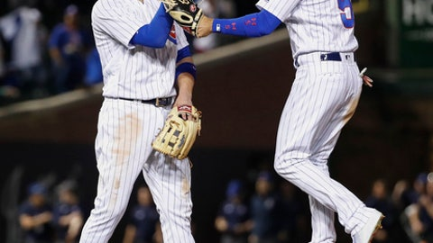 Chicago Cubs' Kris Bryant, left, and Albert Almora Jr., right, celebrate the team's 14-2 win over the Miami Marlins in a baseball game, Monday, May 7, 2018, in Chicago. (AP Photo/Kamil Krzaczynski)