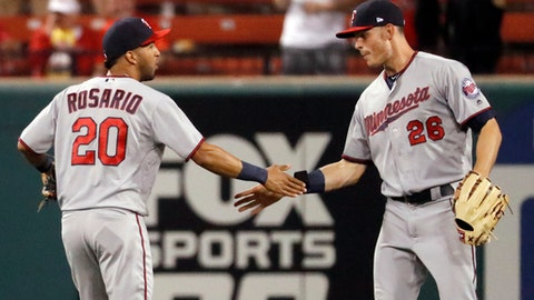 Minnesota Twins' Max Kepler (26) and Eddie Rosario celebrate following a baseball game against the St. Louis Cardinals Monday, May 7, 2018, in St. Louis. The Twins won 6-0. (AP Photo/Jeff Roberson)