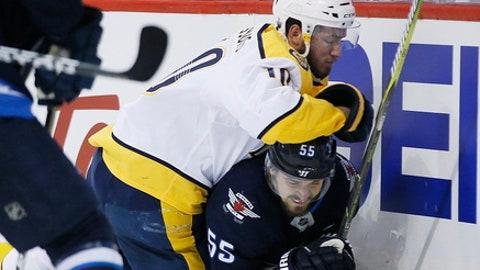 Nashville Predators' Colton Sissons (10) falls on Winnipeg Jets' Mark Scheifele (55) during second period NHL hockey playoff action in Winnipeg, Manitoba, Monday, May 7, 2018. (John Woods/The Canadian Press via AP)