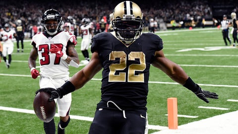 New Orleans Saints running back Mark Ingram (22) crosses the goal line for a touchdown in front of Atlanta Falcons free safety Ricardo Allen (37) in the second half of an NFL football game in New Orleans, Sunday, Dec. 24, 2017. (AP Photo/Bill Feig)