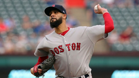FILE - In this May 3, 2018 file photo Boston Red Sox starting pitcher David Price throws to a Texas Rangers batter during the first inning of a baseball game in Arlington, Texas. Price has been sent back to Boston for medical tests after experiencing a tingling sensation in his pitching hand again. Price was scratched from his scheduled start Wednesday, May 9, 2018 against the rival New York Yankees. Red Sox manager Alex Cora says Price felt tingling in his hand Sunday while throwing a bullpen that was cut short, the same symptoms that forced him out of an early-season game against the Yankees in Boston. (AP Photo/Richard Rodriguez)