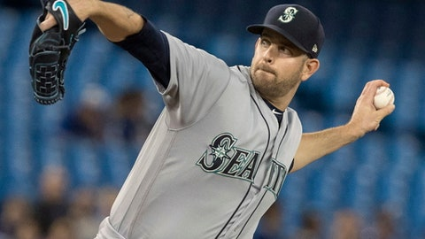 Seattle Mariners starting pitcher James Paxton throws to a Toronto Blue Jays batter during the first inning of a baseball game Tuesday, May 8, 2018, in Toronto. (Fred Thornhill/The Canadian Press via AP)