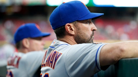 New York Mets manager Mickey Callaway watches from the dugout during the fifth inning of the team's baseball game against the Cincinnati Reds, Tuesday, May 8, 2018, in Cincinnati. (AP Photo/John Minchillo)