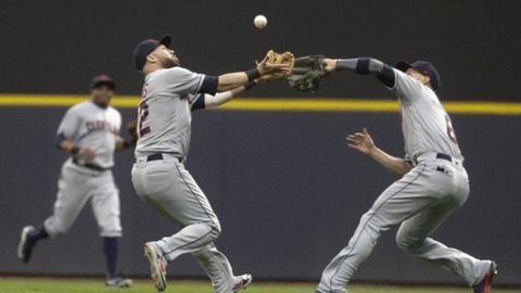 Cleveland Indians' Jason Kipnis and Brandon Guyer collide going after a ball hit by Milwaukee Brewers' Manny Pina during the fourth inning of a baseball game Tuesday, May 8, 2018, in Milwaukee. (AP Photo/Morry Gash)