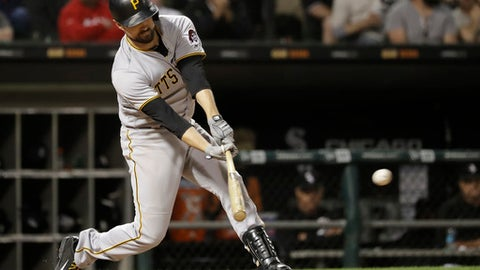 Pittsburgh Pirates' Jordy Mercer hits an RBI single off Chicago White Sox relief pitcher Chris Volstad during the fifth inning of a baseball game Tuesday, May 8, 2018, in Chicago. Colin Moran scored on the play. (AP Photo/Charles Rex Arbogast)
