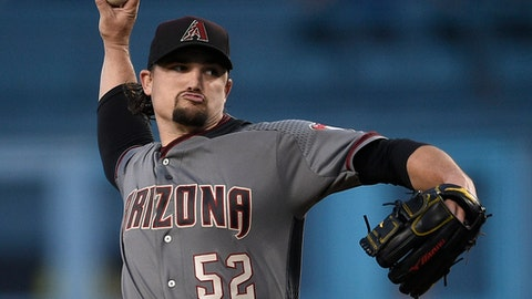 Arizona Diamondbacks starting pitcher Zack Godley throws to a Los Angeles Dodgers batter during the first inning of a baseball game in Los Angeles, Tuesday, May 8, 2018. (AP Photo/Kelvin Kuo)