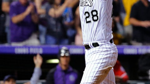 Colorado Rockies' Nolan Arenado celebrates after scoring on a Trevor Story two-run double against the Los Angeles Angels during the seventh inning of a baseball game Tuesday, May 8, 2018, in Denver. (AP Photo/Jack Dempsey)