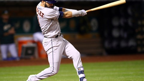 Houston Astros' Marwin Gonzalez swings for an RBI single off Oakland Athletics' Sean Manaea in the sixth inning of a baseball game Tuesday, May 8, 2018, in Oakland, Calif. (AP Photo/Ben Margot)