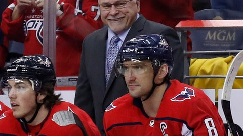 FILE - In this March 12, 2018, file photo, Washington Capitals head coach Barry Trotz smiles towards left wing Alex Ovechkin, right, after Ovechkin's goal in the second period of an NHL hockey game against the Winnipeg Jets in Washington. Ovechkin is finally past the second round of the playoffs. So is coach Trotz. (AP Photo/Alex Brandon, File)