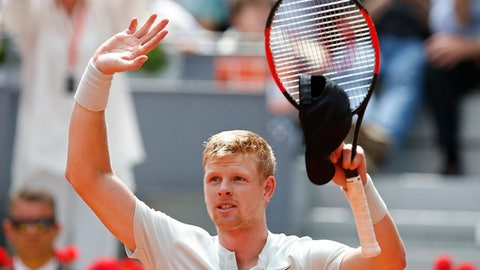 Kyle Edmund of Britain celebrates after beating Novak Djokovic of Serbia 6-3, 2-6, 6-3 during the Madrid Open Tennis tournament in Madrid, Spain, Wednesday, May 9, 2018. (AP Photo/Paul White)