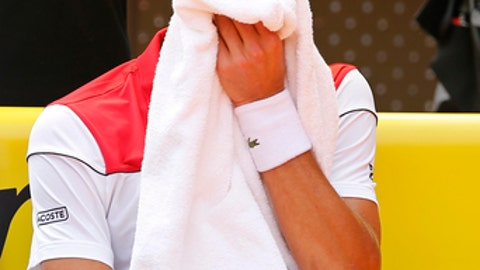 Novak Djokovic of Serbia wipes his face with a towel during his match against Kyle Edmund of Britain during the Madrid Open Tennis tournament in Madrid, Spain, Wednesday, May 9, 2018. (AP Photo/Paul White)