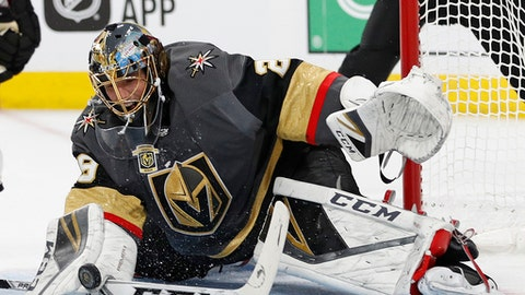 FILE - In this April 26, 2018, file photo, Vegas Golden Knights goaltender Marc-Andre Fleury (29) blocks a shot by the San Jose Sharks during the first period of Game 1 of an NHL hockey second-round playoff series in Las Vegas. After going to the final in 2008 and winning the Stanley Cup in 2009, Marc-Andre Fleury tanked as a playoff goaltender with save percentages under .900 the next four postseasons. Last year with Pittsburgh, Fleury recaptured his form in helping the Penguins win the Cup again and has been one of the best in these playoffs with the Vegas Golden Knights, no surprise to former teammates who can tell when hes in the zone. (AP Photo/John Locher, File)