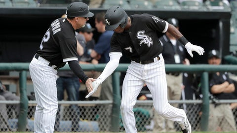 Chicago White Sox's Tim Anderson (7) celebrates his two-run home run off Pittsburgh Pirates starting pitcher Trevor Williams with third base coach Nick Capra during the second inning of a baseball game Wednesday, May 9, 2018, in Chicago. Daniel Palka also scored on the play. (AP Photo/Charles Rex Arbogast)