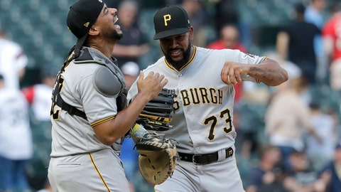 Pittsburgh Pirates catcher Elias Diaz, left, and Felipe Vazquez celebrate the team's 6-5 win over the Chicago White Sox after a baseball game Wednesday, May 9, 2018, in Chicago. (AP Photo/Charles Rex Arbogast)