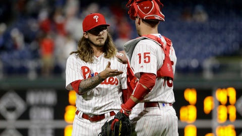 Philadelphia Phillies relief pitcher Zac Curtis, left, and catcher Andrew Knapp meet after the team's 11-3 win in a baseball game against the San Francisco Giants, Wednesday, May 9, 2018, in Philadelphia. (AP Photo/Matt Slocum)