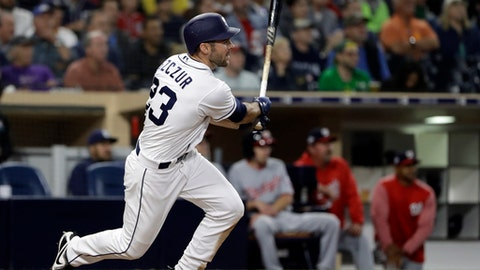 San Diego Padres' Matt Szczur watches an RBI-double during the seventh inning of a baseball game against the Washington Nationals on Wednesday, May 9, 2018, in San Diego. (AP Photo/Gregory Bull)