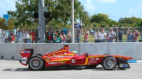 FILE - In this March 14, 2015, file photo, fans watch as the China Racing Formula E Team car practices for the 2015 FIA Formula E Miami ePrix, in Miami. Miami's city commission is scheduled to vote Thursday, May 10, 2018, whether to move forward on a deal with Formula One to stage a Miami Grand Prix in 2019. (David Santiago/El Nuevo Herald via AP, File)