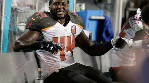 FILE - In this Sept. 3, 2015, file photo, then-Tampa Bay Buccaneers linebacker Khaseem Greene (44) sits on the sidelines after an interception during the first half of an NFL preseason football game against the Miami Dolphins, in Miami Gardens, Fla. Former NFL linebacker Khaseem Green says in a lawsuit that police and prosecutors in New Jersey knew a shooter had lied about getting a weapon from the player, but charged him anyway. A gun charge against Greene was dropped in July after an audio recording surfaced of the other man telling detectives he lied about Greene's involvement in a shooting outside a nightclub in Elizabeth in December 2016.  The Kansas City Chiefs released Greene the day charges against him were reported. The suit, filed Tuesday, May 8, 2018, names the Elizabeth Police Department, and the Union County Prosecutors Office. (AP Photo/Lynne Sladky, File)