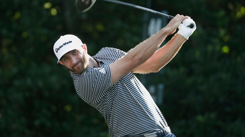 Dustin Johnson hits from the 11th tee during the first round of The Players Championship golf tournament Thursday, May 10, 2018, in Ponte Vedra Beach, Fla. (AP Photo/Lynne Sladky)
