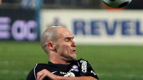FILE - In this file photo dated Saturday, Jan. 26, 2008,  Caen's Benjamin Nivet, during their French League one soccer match in Marseille, southern France. Troyes has two games left to avoid relegation, and its hopes rest on balding 41-year old midfielder Benjamin Nivet, when they face Montpellier on upcoming Saturday. (AP Photo/Claude Paris, FILE)