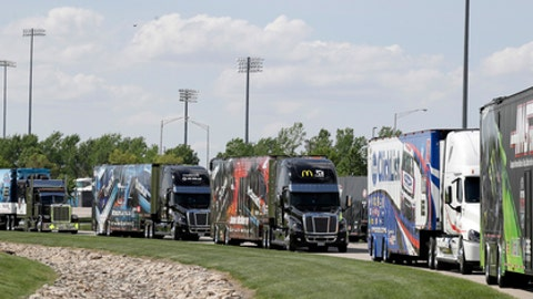 Haulers line up to entering the infield for this weekend's NASCAR auto racing events at Kansas Speedway in Kansas City, Kan., Thursday, May 10, 2018. (AP Photo/Orlin Wagner)