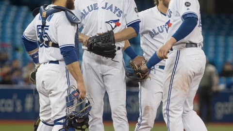 Toronto Blue Jays starting pitcher J.A. Happ waits with teammates for manager John Gibbons to take him out of the baseball game against the Seattle Mariners during the fourth inning Thursday, May 10, 2018, in Toronto. (Fred Thornhill/The Canadian Press via AP)