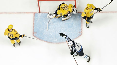 Winnipeg Jets center Paul Stastny (25) celebrates after teammate Tyler Myers, not shown, scored a goal against Nashville Predators goalie Pekka Rinne (35), of Finland, during the first period in Game 7 of an NHL hockey second-round playoff series Thursday, May 10, 2018, in Nashville, Tenn. Also defending for the Predators are Austin Watson (51) and Roman Josi (59), of Switzerland. (AP Photo/Mark Humphrey)