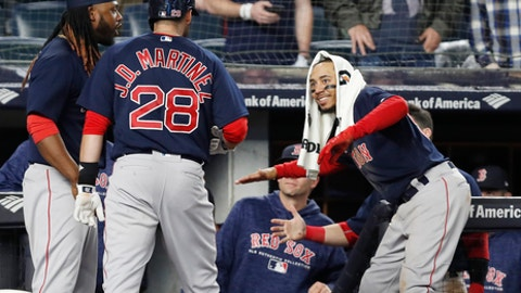Boston Red Sox' Mookie Betts, right, greets J.D. Martinez (28) at the dugout steps after Martinez hit a go-ahead solo home run during the eighth inning of a baseball game against the New York Yankees in New York, Thursday, May 10, 201. Hanley Ramirez is at left. (AP Photo/Kathy Willens)