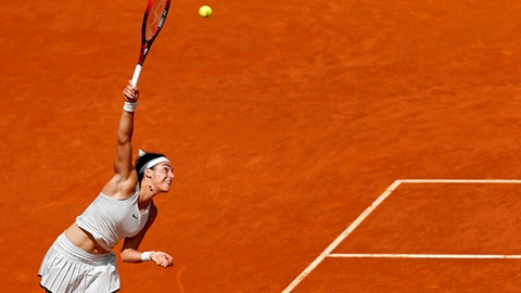 Caroline Garcia from France serves to Kiki Bertens from The Netherlands during a Madrid Open tennis tournament semi final match in Madrid, Spain, Friday, May 11, 2018. (AP Photo/Francisco Seco)