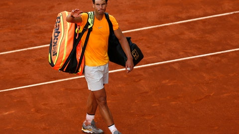 Rafael Nadal from Spain leaves the court after losing to Dominic Thiem from Austria at the end of a Madrid Open tennis tournament match in Madrid, Spain, Friday, May 11, 2018. Thiem won 7-5, 6-3. (AP Photo/Francisco Seco)