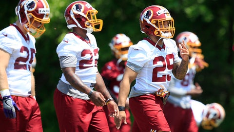 Washington Redskin's second-round pick Derrius Guice (29) and Martez Carter (22) from Grambling State, perform stretching exercises at the NFL football team's rookie minicamp at Redskins Park in Ashburn, Va., Friday, May 11, 2018. (AP Photo/Manuel Balce Ceneta)