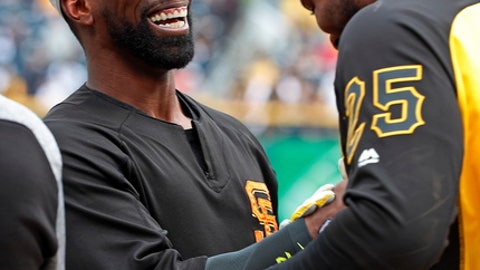 San Francisco Giants' Andrew McCutchen, left, visits with former teammate Pittsburgh Pirates' Gregory Polanco (25) during warmups before a baseball game in Pittsburgh, Friday, May 11, 2018. (AP Photo/Gene J. Puskar)