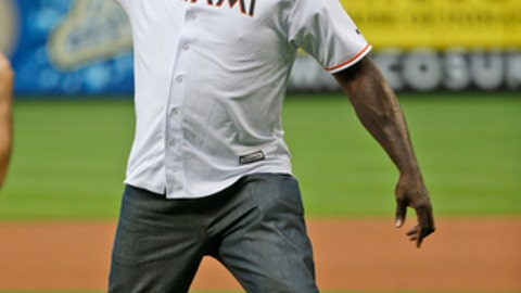 Former NBA player Shaquille O'Neal throws out a ceremonial first pitch before a baseball game between the Miami Marlins and the Atlanta Braves, Friday, May 11, 2018, in Miami. (AP Photo/Wilfredo Lee)