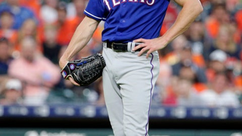 Texas Rangers starting pitcher Cole Hamels reacts after hitting Houston Astros batter George Springer with a pitch during the third inning of a baseball game Friday, May 11, 2018, in Houston. (AP Photo/Michael Wyke)