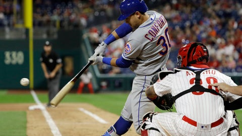 New York Mets' Michael Conforto, left, hits a two-run home run off Philadelphia Phillies relief pitcher Hector Neris during the ninth inning of a baseball game Friday, May 11, 2018, in Philadelphia. At right is catcher Jorge Alfaro. New York won 3-1. (AP Photo/Matt Slocum)