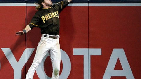 San Diego Padres right fielder Travis Jankowski can't reach a two-run home run hit by St. Louis Cardinals' Tommy Pham during the sixth inning of a baseball game Friday, May 11, 2018, in San Diego. (AP Photo/Gregory Bull)