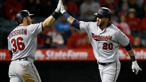 Minnesota Twins' Eddie Rosario, right, gets congratulations from Robbie Grossman after Rosario hits a solo home run against the Los Angeles Angels during the sixth inning of a baseball game in Anaheim, Calif., Friday, May 11, 2018. (AP Photo/Alex Gallardo)