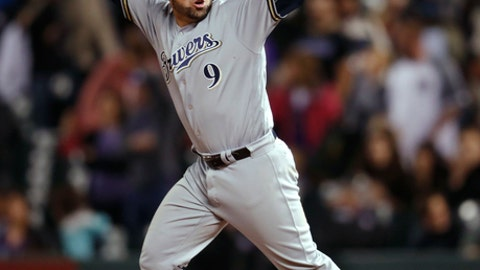 Milwaukee Brewers' Manny Pina celebrates after hitting a two-run home run off Colorado Rockies relief pitcher Wade Davis during the ninth inning of a baseball game Friday, May 11, 2018. (AP Photo/David Zalubowski)