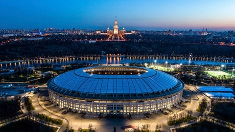 This photo taken on Monday, April 23, 2018, shows an aerial view of the World Cup Luzhniki stadium with the Moscow River and the State University in the background in Moscow, Russia. The Luzhniki stadium will hold the 2018 World Cup final. (AP Photo/Dmitry Serebryakov)