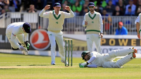 Ireland's Niall O'Brien, left, collides with Pakistan's Imam-ul-Haq on day two of the International Cricket Test Match between Ireland and Pakistan at The Village, Dublin, Saturday, May 12, 2018. (Donall Farmer/PA via AP)