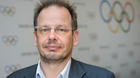 FILE - In this Dec. 5, 2017 file photo Hajo Seppelt, journalist for the German ARD Television, poses for photographer on the side line of the International Olympic Committee, IOC, Executive Board meeting, in Lausanne, Switzerland. German officials called Saturday on the global soccer federation FIFA to intervene after the journalist who exposed systematic doping in Russian athletics was denied entry to Russia to report on the upcoming World Cup.  (Jean-Christophe Bott/Keystone via AP)