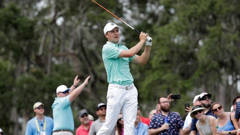 Jordan Spieth watches his tee shot on the 12th hole during the third round of the Players Championship golf tournament, Saturday, May 12, 2018, in Ponte Vedra Beach, Fla. (AP Photo/Lynne Sladky)