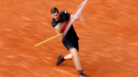 In this photo taken with a slow shutter speed photo, Austria's Dominic Thiem hits a backhand return from  South Africa's Kevin Anderson during a Madrid Open tennis tournament semi final match in Madrid, Spain, Saturday, May 12, 2018. Thiem won 6-4 and 6-2. (AP Photo/Francisco Seco)