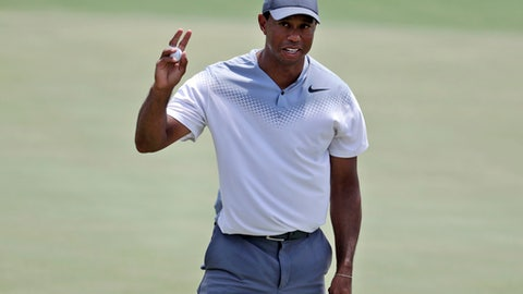Tiger Woods waves on the 18th green during the third round of the Players Championship golf tournament, Saturday, May 12, 2018, in Ponte Vedra Beach, Fla. (AP Photo/Lynne Sladky)