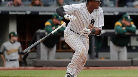 New York Yankees' Miguel Andujar drives in a run with a base hit to left field against the Oakland Athletics during the fifth inning of a baseball game, Saturday, May 12, 2018, in New York. (AP Photo/Julie Jacobson)