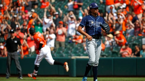 Tampa Bay Rays starting pitcher Chris Archer, right, waits for Baltimore Orioles Jonathan Schoop, back left, to round the bases on his solo home run in the third inning of the first baseball game of a doubleheader, Saturday, May 12, 2018, in Baltimore. (AP Photo/Patrick Semansky)