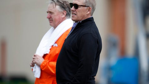 Denver Broncos general manager John Elway, front, joins Joe Ellis, the team's president and chief executive officer, in looking on during an orientation session for the team's rookies Saturday, May 12, 2018, at the Broncos' headquarters in Englewood, Colo. (AP Photo/David Zalubowski)